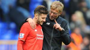 Liverpool manager Juergen Klopp talks to Liverpool's Adam Lallana after the English Premier League soccer match between Tottenham Hotspur and Liverpool at the White Hart Lane, London, England, Saturday, Oct. 17, 2015. (AP Photo/Rui Vieira)